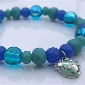 Jewelry - Blue Beaded Stretch Bracelet w/ Ladybug Charm